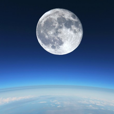 Full Moon over Earth's stratosphere.