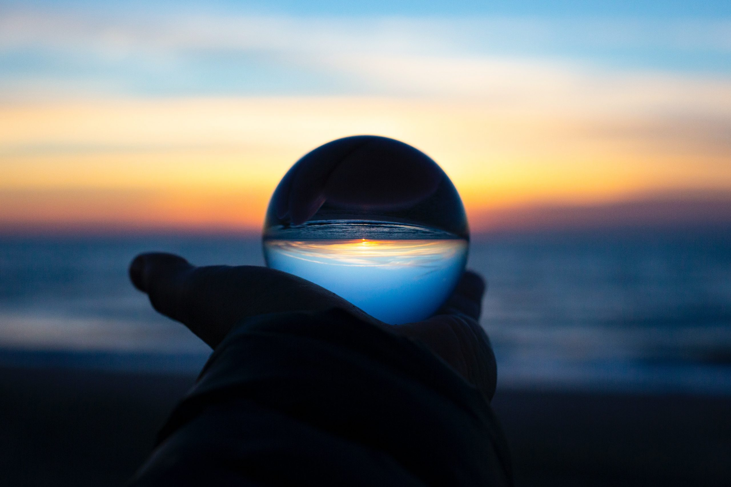 Crystal ball and ocean sunset